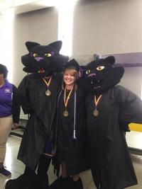 Sammy and mascots in graduation robes