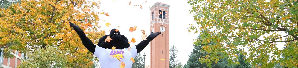 TC throwing leaves in front of the Campanile